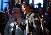 United States President Barack Obama visits a bar in celebration of St. Patrick's day at the Dubliner Restaurant and Pub on March 17, 2012 in Washington, DC. Next week, Obama and Vice President Biden will meet the Irish Prime Minister Enda Kenny and attend a St. Patrick's Day lunch at the Capitol. .Credit: Joshua Roberts / Pool via CNP