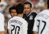 Ramiro Corrales of Earthquakes argues with Davide Chiumiento of Whitecaps during the game at Buck Shaw Stadium in Santa Clara, California on April 7th, 2012.  San Jose Earthquakes defeated Vancouver Whitecaps, 3-1.