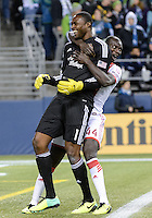 November, 2013: CenturyLink Field, Seattle, Washington:  Portland Timbers goalkeeper Donovan Ricketts (1) and Pa Modou Kah (44) celebrate as the Portland Timbers take on the Seattle Sounders FC in the Major League Soccer Playoffs semifinals Round. Portland won the first match 2-1.