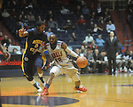 "Ole Miss guard Chris Warren (12) is guarded by Murray State guard Isacc Miles at the C.M. ""Tad"" Smith Coliseum in Oxford, Miss. on Wednesday, November 17, 2010."