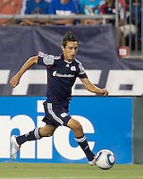 New England Revolution forward Diego Fagundez (14) brings the ball forward. In a Major League Soccer (MLS) match, Chivas USA defeated the New England Revolution, 3-2, at Gillette Stadium on August 6, 2011.