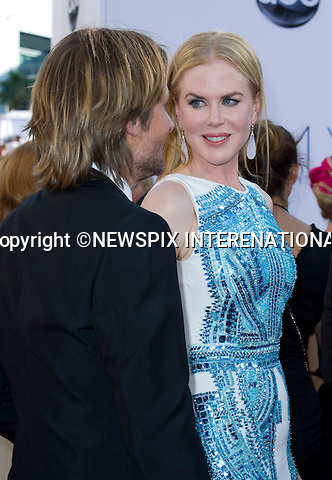 """NICOLE KIDMAN AND KEITH URBAN - 64TH PRIME TIME EMMY AWARDS.Nokia Theatre Live, Los Angelees_23/09/2012.Mandatory Credit Photo: ©Dias/NEWSPIX INTERNATIONAL..**ALL FEES PAYABLE TO: """"NEWSPIX INTERNATIONAL""""**..IMMEDIATE CONFIRMATION OF USAGE REQUIRED:.Newspix International, 31 Chinnery Hill, Bishop's Stortford, ENGLAND CM23 3PS.Tel:+441279 324672  ; Fax: +441279656877.Mobile:  07775681153.e-mail: info@newspixinternational.co.uk"""