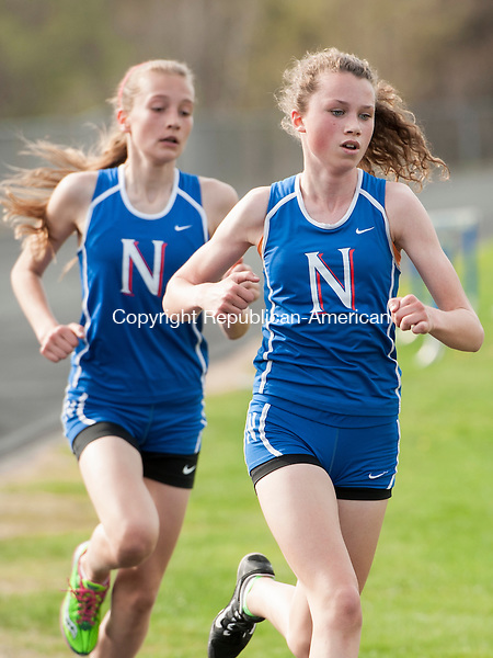 BURLINGTON, CT-5 May 2015-050515EC04-  Nonnewaug's Emily Wingard pulls away from teammate Mary Bibbey to place first in the 1600 meter race Tuesday in Burlington. The two ran side by side until the last leg. Erin Covey Republican-American