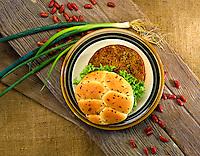 Veggie burger with onion bun and lettuce