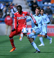 Chicago Fire midfielder Patrick Nyarko (14) battles for the ball with Sporting KC defender Scott Lorenz (24).  The Chicago Fire defeated Sporting KC 3-2 at Toyota Park in Bridgeview, IL on March 27, 2011.