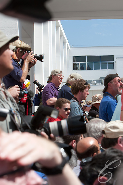 Photographers await the departure of the Discovery astrouants for the launch pad February 24, 2011.