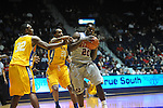 "Ole Miss' Nick Williams (20) vs. McNeese State's Desharick Guidry (32) and McNeese State's Adrian Fields (20) at the C.M. ""Tad"" Smith Coliseum in Oxford, Miss. on Tuesday, November 20, 2012. .."