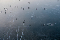 People walk on the ice covered Baltic Sea in Rewa.