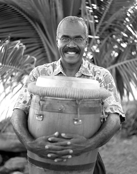 FORT DE FRANCE, MARTINIQUE : A Bele drummer hugs his drum in happiness. Fort de France, Martinique. Caribbean.