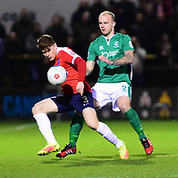 York City's Alex Whittle shields the ball from Lincoln City's Bradley Wood<br /> <br /> Photographer Andrew Vaughan/CameraSport<br /> <br /> The Buildbase FA Trophy Semi-Final First Leg - York City v Lincoln City - Tuesday 14th March 2017 - Bootham Crescent - York<br />  <br /> World Copyright &copy; 2017 CameraSport. All rights reserved. 43 Linden Ave. Countesthorpe. Leicester. England. LE8 5PG - Tel: +44 (0) 116 277 4147 - admin@camerasport.com - www.camerasport.com