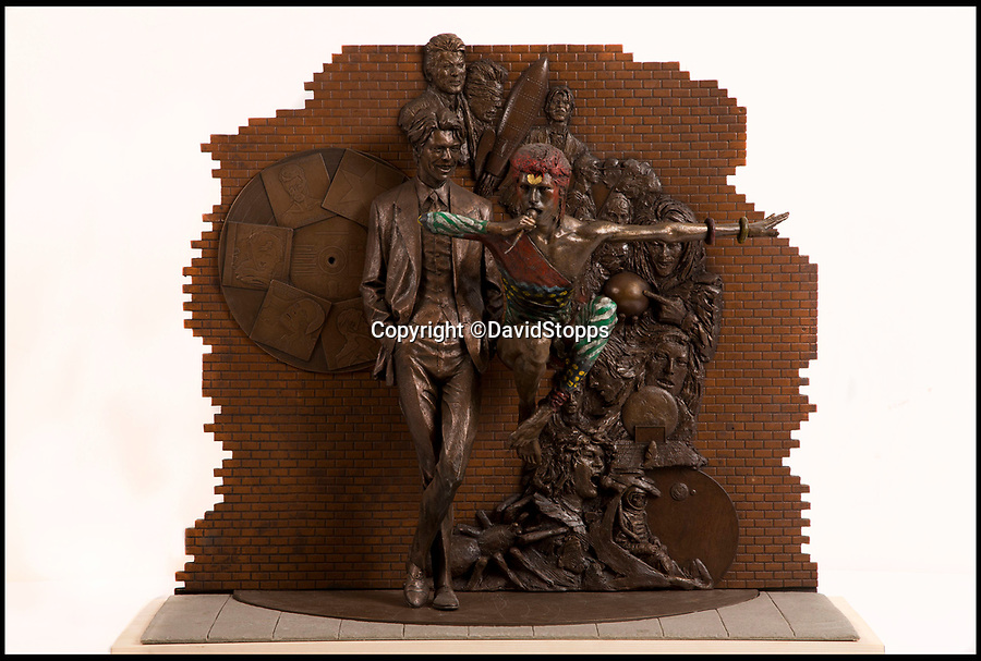 BNPS.co.uk (01202 558833)<br /> Pic: DavidStopps/BNPS<br /> <br /> The maquette of the Andrew Sinclair David Bowie statue design.<br /> <br /> The return of the Thin White Duke...The statue will also include a lifesize Ziggy Stardust attached to the suited Bowie of a later era.<br /> <br /> The world's first statue of David Bowie is taking shape in sculpter Andrew Sinclair's Devon studio.<br /> <br /> Ever since the music legend's death in January 2016 there has been a clamour for a fitting tribute of Bowie to be made.<br /> <br /> While his birthplace of Brixton, south London, has been cited as the most likely location for one it is actually Aylesbury in Buckinghamshire that will lay claim to having the very first statue of him.<br /> <br /> The market town was where Bowie played an experimental gig in 1971 to see if had the confidence to perform live and then a year later where his alter-ego of Ziggy Stardust was born.<br /> <br /> One half of the statue has been completed by artist Andrew Sinclair. It depicts a handsome Bowie in his 'Blue Suit' period in the 1990s.