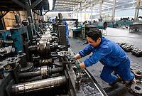 Steel workers in a steel factory in Huashi, near Jiangyin, Jiangsu province, China, on June 27, 2009. Photo by Lucas Schifres/Pictobank
