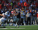 Ole Miss' Jeff Scott (3) eludes Southern Illinois' Mike McElroy (26) to score at Vaught-Hemingway Stadium in Oxford, Miss. on Saturday, September 10, 2011. Ole Miss won 42-24. Scott scored four touchdowns.