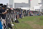 Cameras fill every available inch along the front edge of the press site as the Space Shuttle Atlantis lifts off for the final time on Friday, July 8, 2011.  Atlantis' mission is the final one of the shuttle program's 30 year history and leaves NASA without manned spaceflight launch capability.
