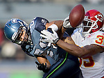 Kansas City Chiefs cornerback Travis Daniels (R) knocks away a pass intended for Seattle Seahawks' tight end John Carlson in the first quarter on Sunday  November 28, 2010 at Qwest Field in Seattle.  The Chiefs beat the Seahawks 42-24.   (UPI /Jim Bryant)