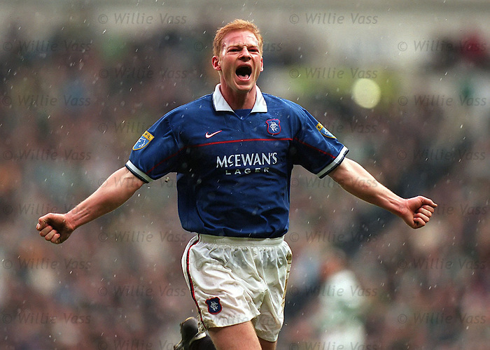 Jorg Albertz runs to the Rangers support after scoring his second goal during the Old Firm Match at Ibrox April 1998