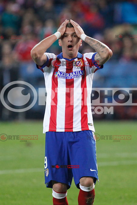 Atletico de Madrid´s Mandzukic reacts regretting a goal chance during Champions League soccer match between Atletico de Madrid and Olympiacos at Vicente Calderon stadium in Madrid, Spain. November 26, 2014. (ALTERPHOTOS/Victor Blanco) /NortePhoto