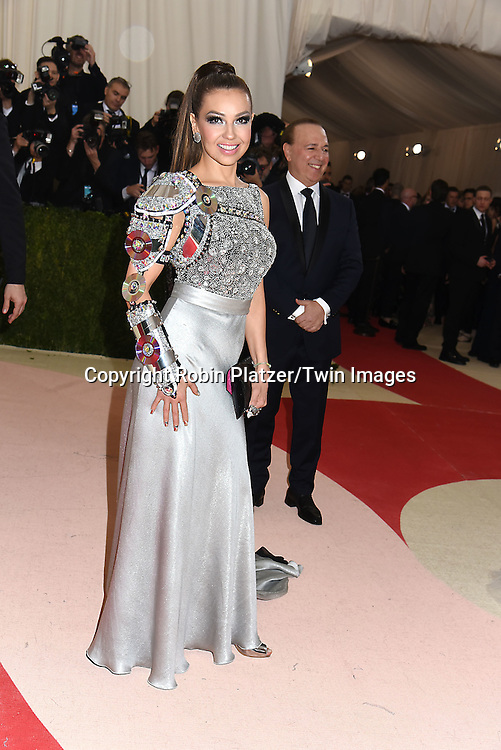 Thalia and Tommy Mottola attends the Metropolitan Museum of Art Costume Institute Benefit Gala on May 2, 2016 in New York, New York, USA. The show is Manus x Machina: Fashion in an Age of Technology. <br /> <br /> photo by Robin Platzer/Twin Images<br />  <br /> phone number 212-935-0770