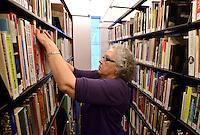 NWA Democrat-Gazette/BEN GOFF -- 02/23/15 Tamara Burgh of Bella Vista shelves books while volunteering in the library at Crystal Bridges Museum of American Art in Bentonville on Monday Feb. 23, 2014.