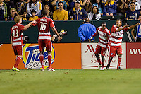 FC Dallas players (l to r) Dax McCarty, Atiba Harris, Marvin Chavez and David Ferreira begin the goal dance after Ferreira found the back of the net. FC Dallas defeated the LA Galaxy 3-0 to win the Western Division 2010 MLS Championship at Home Depot Center stadium in Carson, California on Sunday November 14, 2010.