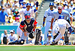 24 July 2011: Washington Nationals catcher Jesus Flores is unable to handle the throw home as Matt Kemp slides home safely to score the Dodgers' second and game-winning run at Dodger Stadium in Los Angeles, California. The Dodgers defeated the Nationals 3-1 to take the rubber match of their three game series. Mandatory Credit: Ed Wolfstein Photo