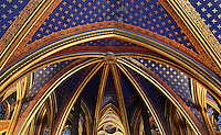 Detail of the ceiling in the choir of the lower chapel of La Sainte-Chapelle (The Holy Chapel), 1248, Paris, France. The ribs are underlined with red strips and golden L on the vaults decorated with fleur de lys. La Sainte-Chapelle was commissioned by King Louis IX of France to house his collection of Passion Relics, including the Crown of Thorns, and is considered among the highest achievements of the Rayonnant period of Gothic architecture. Picture by Manuel Cohen