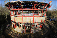 BNPS.co.uk (01202 558833)<br /> Pic: GPO/BNPS<br /> <br /> Taking shape in early 2017.<br /> <br /> Your starter for 10 - Where is the first opera house to be built in Britain in over 20 years about to open its doors?<br /> <br /> If your answer was West Horsley Place in Surrey - the grand country estate inherited out-of-the blue by former University Challenge host Bamber Gascoigne - then you would be on your three bonus questions by now.<br /> <br /> The impressive horse-shoe shaped building is nearing completion in a wooded area of the 350 acre estate following a whirlwind development costing &pound;10m.<br /> <br /> The Theatre in the Woods, which will have a capacity for 700 opera buffs spread over four tiers, is the new home for the prestigious Grange Park Opera.<br /> <br /> The building, a scaled-down version of the historic La Scala opera house in Milan, will open on June 8 with a performance of Puccini's Tosca.