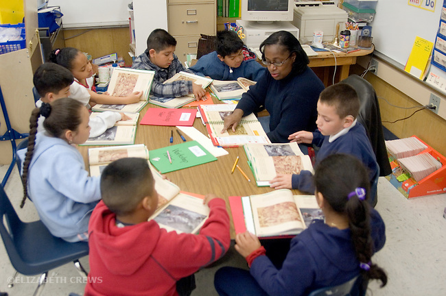 """Oakland CA 2nd grade teacher leading group reading (all using same book) in """"Open Court"""" classroom"""