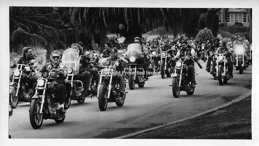 Hells Angels procession entering Evergreen Cemetary in Oakland, California for a funeral. (1985 photo by Ron Riesterer)