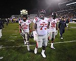 Ole Miss' Mike Marry (52), Ole Miss' Alex Washington (73), and Ole Miss' Gerald Rivers (90) walk off the field vs. Mississippi State in Starkville, Miss. on Saturday, November 26, 2011.