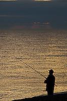 Cley Next The Sea, Norfolk, England, 05/08/2009..Sea fishing at dawn.