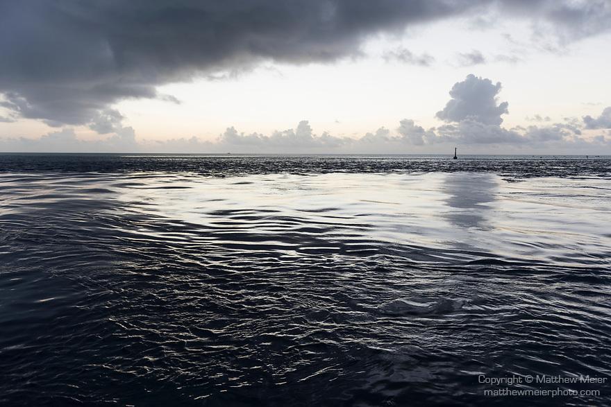 Fakarava Atoll, Tuamotu Archipelago, French Polynesia; view of sunset clouds over the Tetamanu Pass from the docks of Tetamanu Village