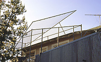 Frank Gehry: Gehry House, Santa Monica. Detail of chain link burglar stopper, or something. Washington Ave. side.  Photo '86.