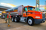 Nov. 3, 2012 - Merrick, New York, U.S. - A gas truck arrives at the Merrick Hess, one of the Long Island gas stations open the Saturday after Hurricane Sandy battered this south shore area. U.S. Army National Guard members from Syracuse were at the station to help Nassau County police maintain order in the long lines of people on foot and in cars waiting their turn at the pumps. The Freeport Armory in the next town was supposed to have free gas, up to 10 gallons for each car, this day, but people who showed up there were turned away. About 500,000 of the 1.2 million Long Islanders who lost power still didn't have it, and the area continued to suffer from severe damage from floods and wind.