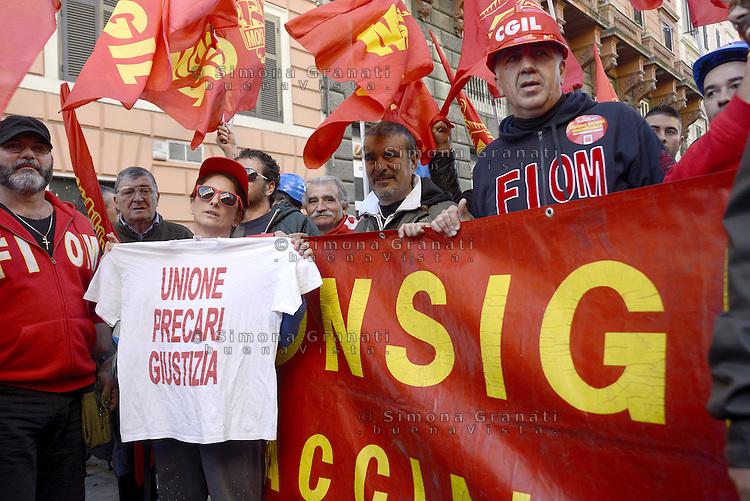 Roma, 25 Ottobre 2014<br /> Lavoro. La CGIL manifesta a Roma con due cortei nazionali fino a Piazza San Giovanni , contro il jobs act e la riforma dell'art.18 del governo Renzi.<br /> FIOM<br /> CGIL protest against the jobs act and the reform of article 18 of the government Renzi.<br /> <br /> Rome, October 25, 2014 <br /> Work. The national union CGIL manifested in Rome with two national marches to Piazza San Giovanni, against the jobs act and the reform of article 18 of the government Renzi.