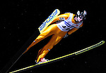 Wolfgang Loitzl of Austria soars through the night during the FIS World Cup Ski Jumping in Sapporo, northern Japan in February, 2008.