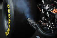 May 5, 2012; Commerce, GA, USA: Detailed view of smoke coming from the header pipes of an NHRA top fuel dragster in the pits during qualifying for the Southern Nationals at Atlanta Dragway. Mandatory Credit: Mark J. Rebilas-