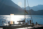 A family docks their boat at Varenna, Italy on Lake Como