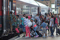 Illegal migrants get on their train to travel to Germany at the main railway station Keleti in Budapest, Hungary on August 31, 2015. ATTILA VOLGYI