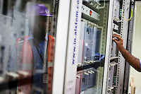An employee is seen working on ALSTOM's STDC in the Signalling Equipment Room (SER) at the Baiyappanahalli depot and primary station in Bangalore, Karnataka, India on 10th March 2011..Photo by Suzanne Lee/Abaca Press