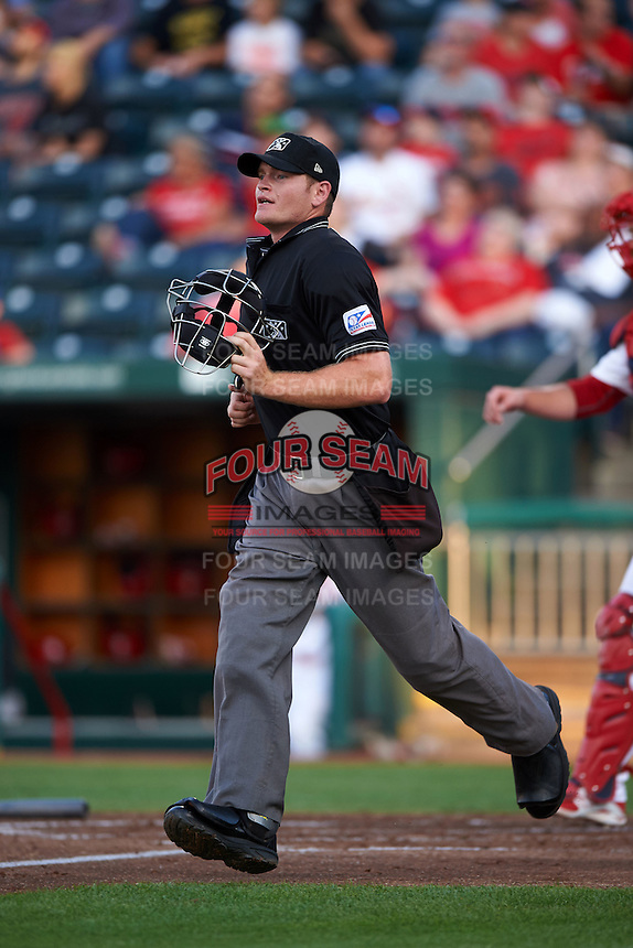 Umpire Jake Wilburn during a game between the Frisco RoughRiders and Springfield Cardinals on June 4, 2015 at Hammons Field in Springfield, Missouri.  Frisco defeated Springfield 8-7.  (Mike Janes/Four Seam Images)