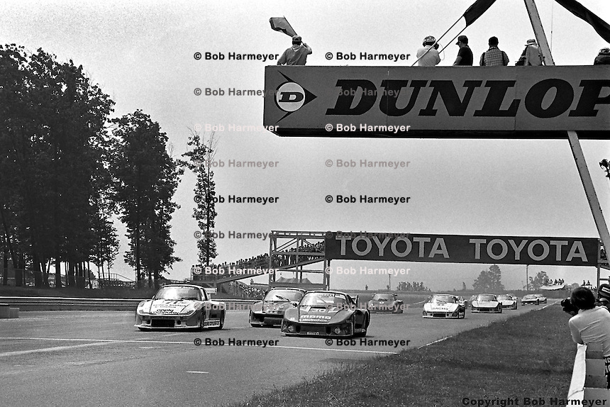 Bobby Rahal (#71, left) leads the field from pole position at the start of the 1980 Watkins Glen 6 Hours race at Watkins Glen International, Watkins Glen, New York, USA.
