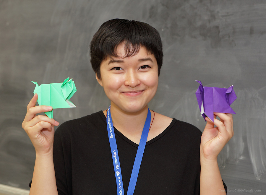 Esme Cribb teaches a class an origami Scolli Pig designed by Sok Song.