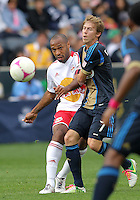 CHESTER, PA - OCTOBER 27, 2012:  Brian Carroll (7) of the Philadelphia Union can't stop a pass from  Thierry Henry (14) of the New York Red Bulls during an MLS match at PPL Park in Chester, PA. on October 27. Red Bulls won 3-0.