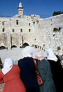 Jerusalem, Israel, November, 1980. Muslims after their praying passing in front of the Wailing Wall.