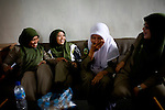 Sharia Police, or the morality police, socialize at the station before going out on patrol in Banda Aceh, Indonesia, on Friday, Nov 20, 2009. The city enforces a moderate form of Islamic Law.,