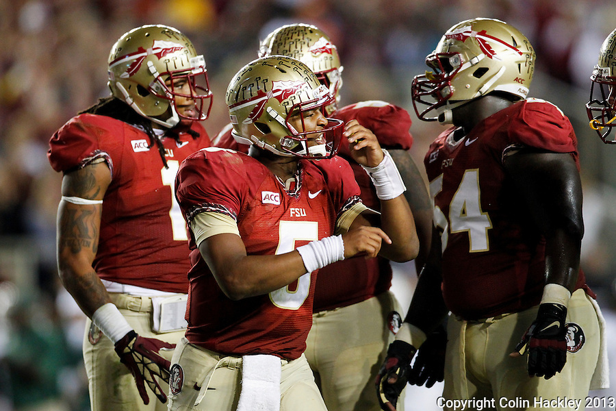 TALLAHASSEE, FL 11/2/13-FSU-MIAMI110213CH-Florida State Jameis Winston rallies his team against Miami during second half action Saturday at Doak Campbell Stadium in Tallahassee. The Seminoles beat the Hurricanes 41-14.<br /> COLIN HACKLEY PHOTO
