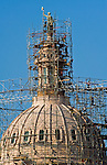 The dome of the Texas State Capitol covered by scaffolds and construction workers, Austin Texas, August 12, 2010.  The Texas State Capitol  was constructed from 1882-88 and is the largest state capitol building in the United States and is currently undergoing restoration work.