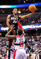 Norris Cole of the Heat goes to the basket against Shelvin Mack of the Wizards. Miami defeated Washington 106-89 at the Verizon Center in Washington, D.C. on Friday, February 10, 2012. Alan P. Santos/DC Sports Box