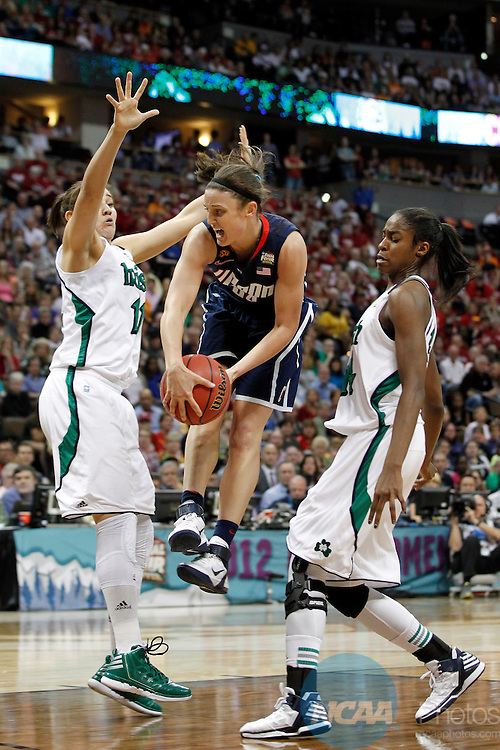 01 APRIL 2012:  Kelly Faris (34) of the University of Connecticut passes to a teammate against the University of Notre Dame during the Division I Women's Final Four Semifinals at the Pepsi Center in Denver, CO.  Notre Dame defeated UCONN 83-75 to advance to the national championship game.  Jamie Schwaberow/NCAA Photos